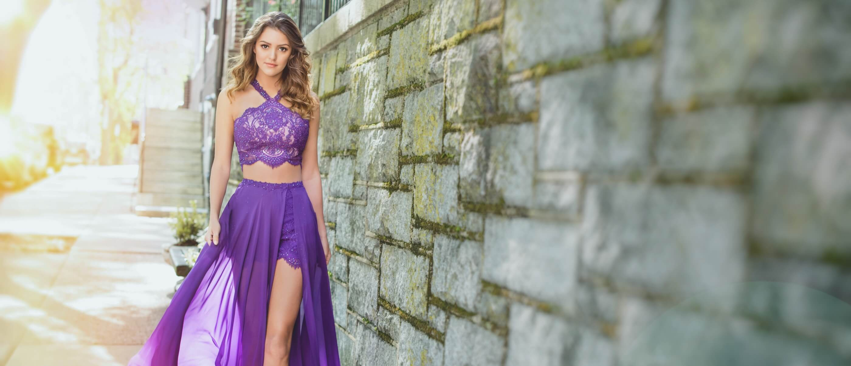 Brunette in purple two piece dress